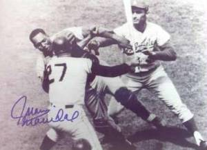 Rare photograph, autographed by Juan Marichal, showing him clubbing John Roseboro with a bat as fellow Hall of Fame pitcher Sandy Koufax rushes to intervene.