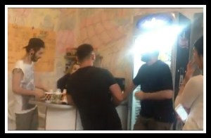 Men in black shirts confronting Kiwi Cafe staff & patrons, in another incident. (From Kiwi Cafe video)