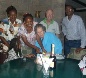 "A family birthday, Rosalie Osborn at center, David Gies behind her. The ""champagne"" on the table was non-alcoholic."
