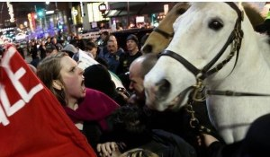 April Foster yelling toward Dan the police horse. (From YouTube video.)