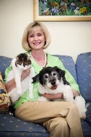 Robin Starr with cat and dog believed to be Louie. (Richmond SPCA photo)
