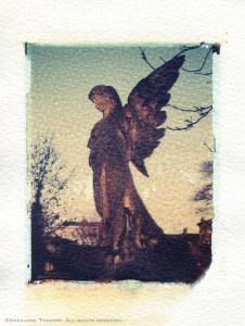 A stone cemetery angel in Kensall Green Cemetery. Polaroid transfer.