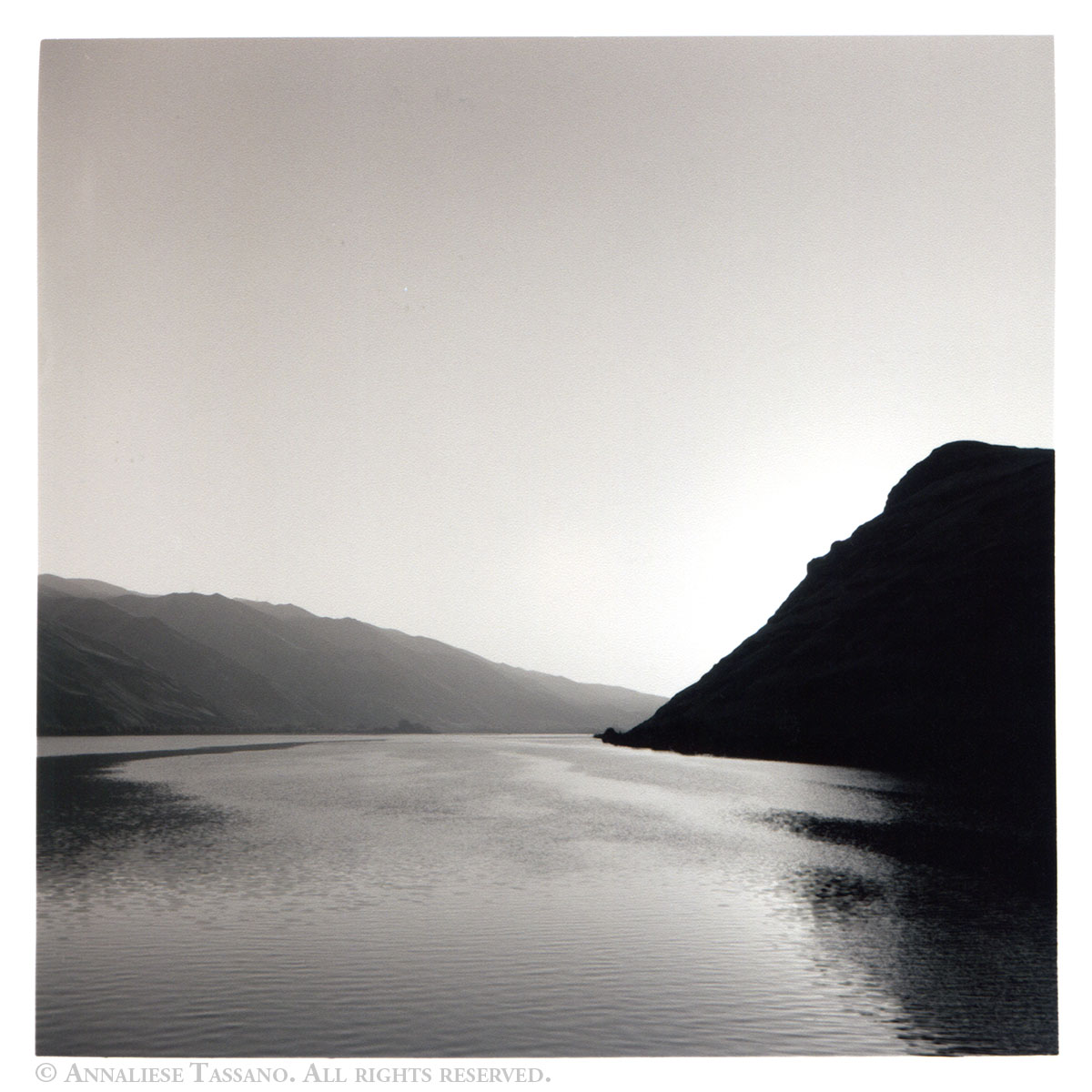 A black and white view of the Columbia river, flowing between Oregon and Washington at Sunset.