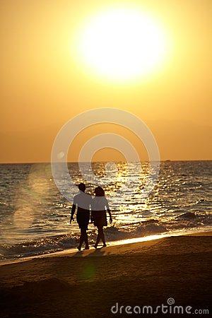 silhouette-love-couple-walking-beach-romantic-hand-hand-sunset-36843515