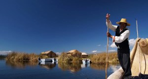 Leaving the floating Island of the uros to go cutting totora reeds in one of their traditional boats