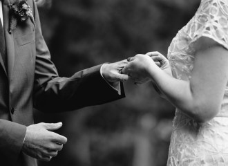 Hands of loving couple @ Blue Mountains wedding