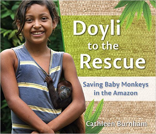 Cover of book, with photo of Doyli holding a baby monkey.