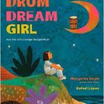 Girl sitting on ground, gazing at moon, on which a drum rests.