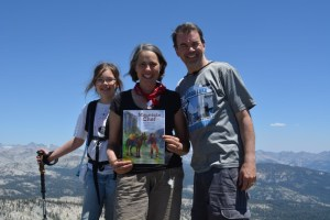 Annette Bay Pimentel holds Mountain Chef on the top of Sing Peak, with her daughter and husband.