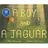 boy and jaguar in the forest