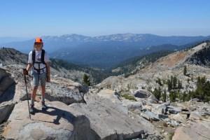 Ten year old girl on a mountain peak