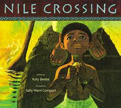 Cover of book shows boy dressed as an ancient Egyptian on a reed boat, as a grown-up paddles.