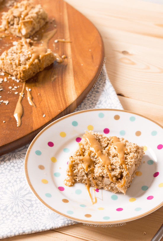 Caramel Apple Oatmeal Bars | Annie's Noms - These Caramel Apple bars are so easy to make, yet beautifully satisfying! A crumble oat mixture is layered with spiced apples before being baked and drizzled with caramel sauce. All of our favourite Fall flavours in one bar.