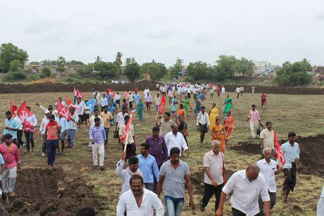 People arrive at the site of the Dalit land agitation at Devarapalli.