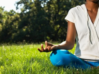 Woman Doing Yoga --- Image by © Royalty-Free/Corbis