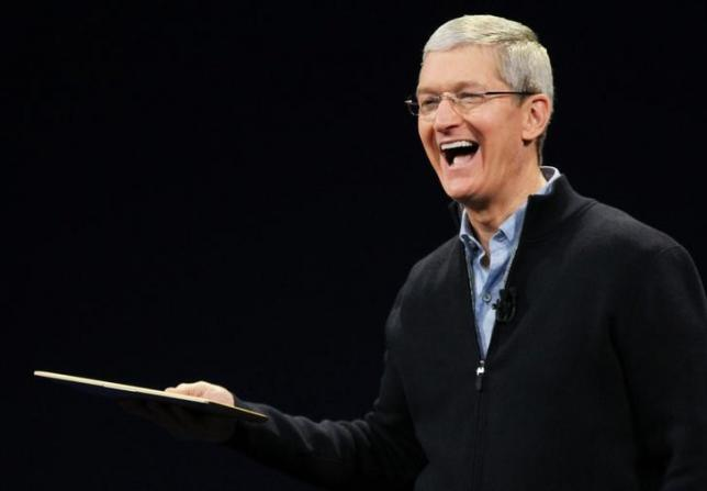 Apple CEO Tim Cook shows the new MacBook during an Apple event in San Francisco, California March 9, 2015. REUTERS/Robert Galbraith