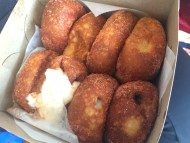 Leonard's Bakery (Oahu): Malasadas are Portuguese donuts that are fried crisy and filled with chocolate or vanilla cream. We chose the ones that came sprinkled with Li Hing, a sweet-tangy sugary powder