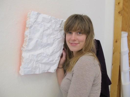 Elliana made glowing, wrinkled, plaster paintings