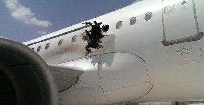 Authorities are trying to figure out the reason for an explosion and fire that blew a gaping hole into the side of a Somali jetliner Tuesday, forcing an emergency landing at the airport on Mogadishu.