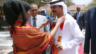 A local artist puts a welcome garland on DP World chairman Sultan bin Sulayem during his arrival at the presidential palace Hargeisa City, Somaliland. Pawan Singh / The National