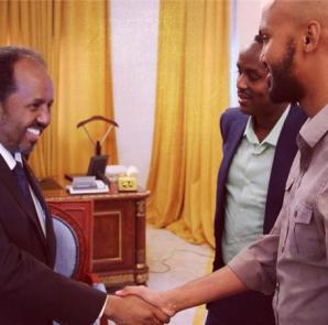 President Hassan Sheikh Mohamud shakes hands with Al Jazeera's journalist in September 2014 at the Presidential Palace [Al Jazeera]