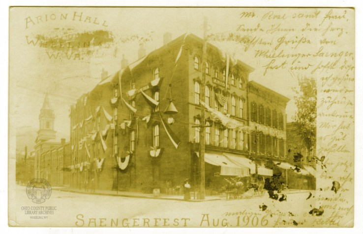 Arion Hall at 20th and Main Streets is decorated for the 1906 Saengerfest parade in this real photo postcard. Ohio County Public Library Archives.