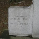 Carving on the base of the Wheeling Doughboy.