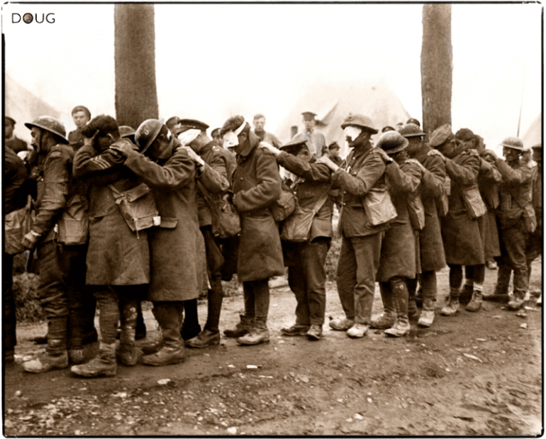 British 55th (West Lancashire) Division troops blinded by a gas attack, await treatment at an Advanced Dressing Station near Bethune during the Battle of Estaires, Nord-Pas-de-Calais on the 10th of April 1918, part of the German offensive in Flanders.
