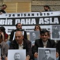 Activists holding photos of murdered Armenian intellectuals during the Genocide commemoration at the Haydarpasha Station in Istanbul. (Photo by Mujgan Arpat)