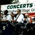 Joe Almasian (front row, right) playing his baritone sax in a community concert at the Framingham Village Green, a favorite pastime before his death at age 79.