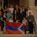 Avetisyan surrounded by R.I. Armenian community members holding the Artsakh flag after the House vote. (Photo by Berge Ara Zobian)