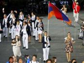 Arman Yeremian (Taekwondo), the flag bearer, and the Armenian delegation at the 