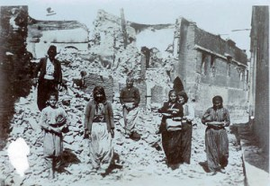 Armenian survivors of the massacres at the ruins of their houses