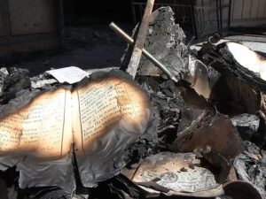 Remains of burned Coptic religious texts outside the al-Amir Tadros Church in Minya city on August 19, 2013 (Copyright Matt Ford-HRW)