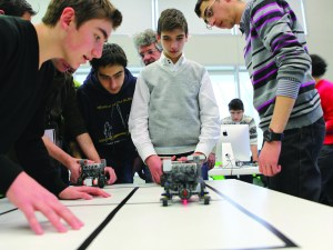 Students experiment in robotics during a workshop.