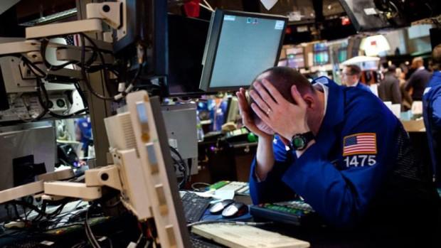 NYSE trader holding head