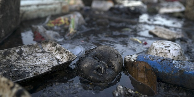 Sewage and debris sits in a Rio de Janeiro waterway
