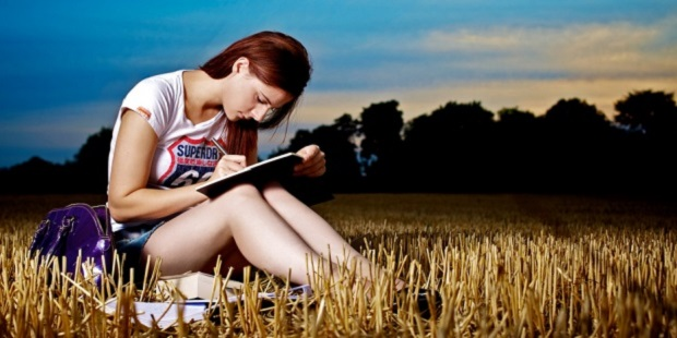 Writer working in a field