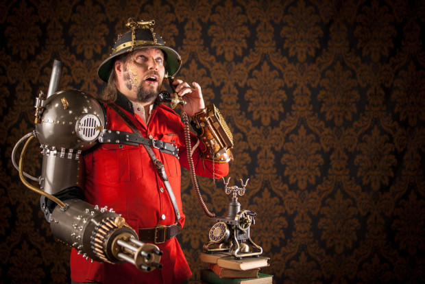 worst drug dealers: Steampunk guy with mechanical arm talking on the phone.