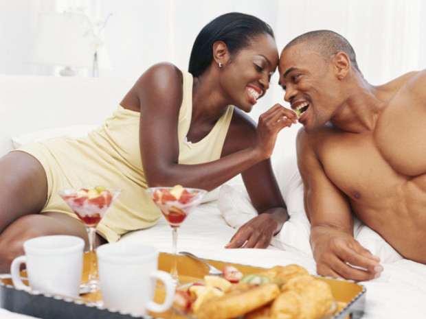 Libido: Woman feeding a man in bed