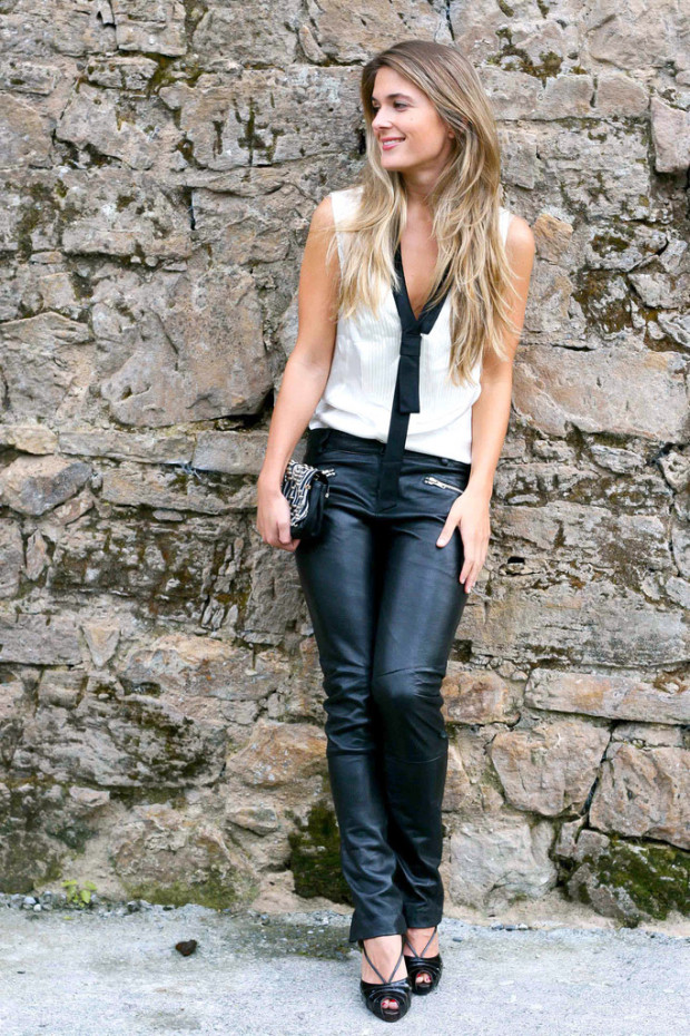big oil: attractive blonde woman with white top and black leather pants