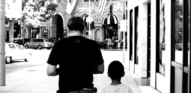Photo of father and son walking