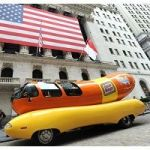 The Oscar Mayer Wienermobile vehicle is seen outside of the New York Stock Exchange as part of its day-long 75th birthday celebration, Monday, July 18, 2011. To commemorate the milestone, the Oscar Mayer brand rang the closing bell at NYSE.  (Diane Bondareff/AP Images for Oscar Mayer)
