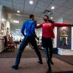 New York-based dancers Jacoby Pruitt (from left) and  Khalia Campbell from Ailey II perform at Country Club Bank in Prairie Village, Kan. The two danced in pop up performances around the city. (Photo/ Julie Denesha)