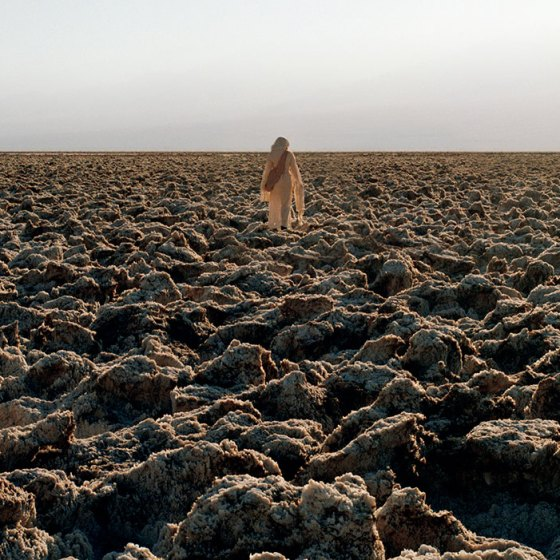 woman walking in arid landscape