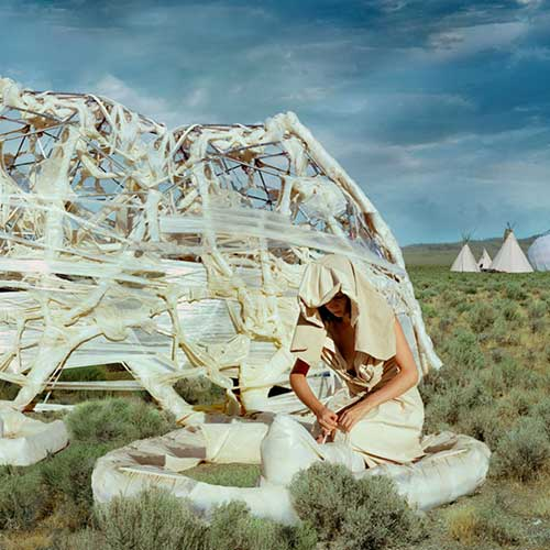 woman in landscape with portable architecture