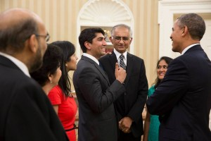 Aneesh Raman with his family greeting President Obama. Raman's hand is on his dad's shoulder