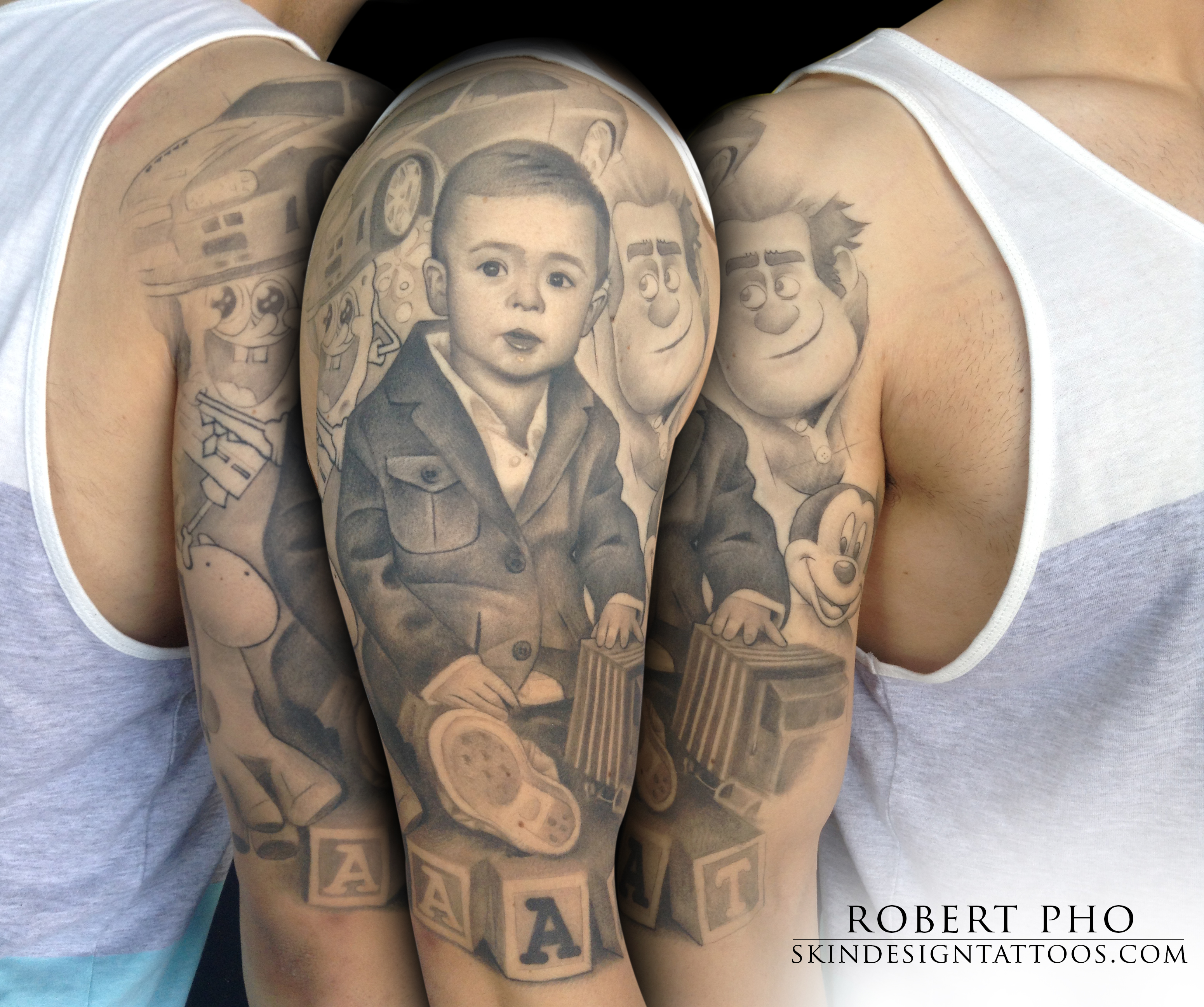Awesome 3d baby portrait tattoo on man left half sleeve by robert pho