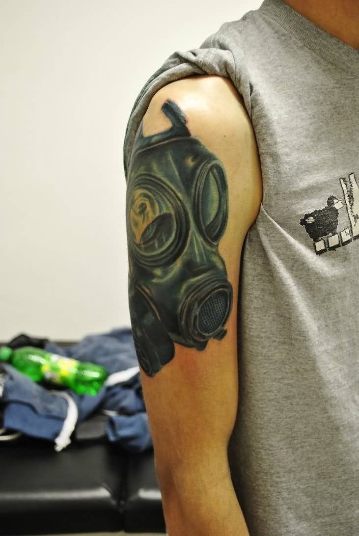 Right bicep gas mask tattoo for men