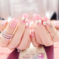 Pink Nails With Pearls And 3D Bow Design Nail Art